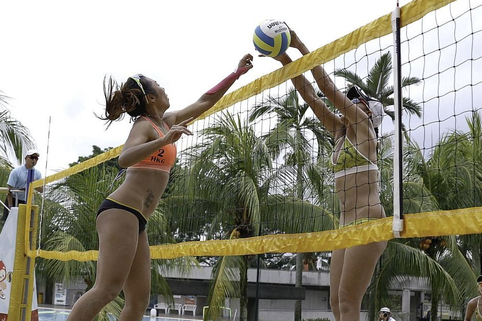 Hong Kong's Wong Yuen Mei (right) blocking a shot by compatriot Au Yeung Wai Yan in the pool rounds of the Singapore Beach Volleyball National Series at Yio Chu Kang Swimming Complex courts on Saturday. In yesterday's final of the two-day competition
