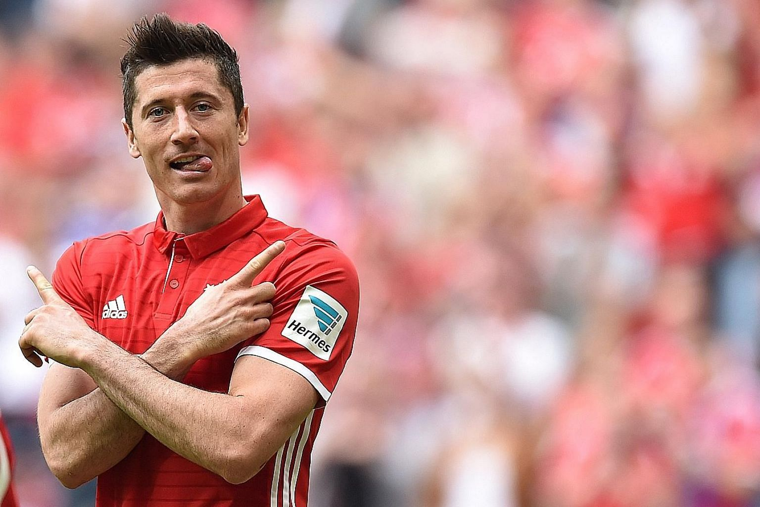 Robert Lewandowski celebrating one of his three goals against Augsburg in the Bundesliga. The Pole is in top form as Bayern chase a treble of league, cup and European titles.