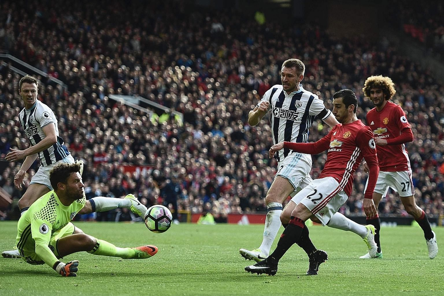 An attempt by United midfielder Henrikh Mkhitaryan being saved by West Brom goalkeeper Ben Foster during their game at Old Trafford. Manager Jose Mourinho has lamented the eight draws and one loss at home that have left them outside the top four spot