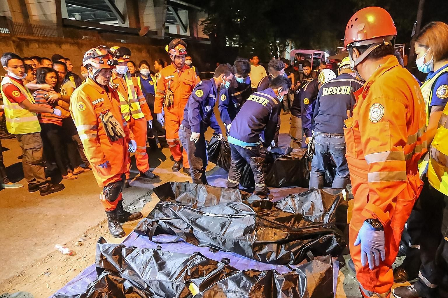 Rescue workers at work after an explosion in Davao City on Sept 2 last year. Suspected bomber Mohammad Abduljabbar Sema was arrested by Malaysian police in November after he fled from the Philippines.