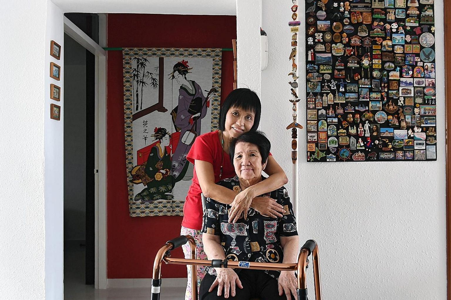 (Above) Ms Janet Koh with her mother, Madam Ng Sook Cheng, whom she has been caring for full-time since 2010. Having cared for her father-in-law and husband, who have both died, gave Madam Liaw Lay Kian (left) the desire to work in a hospice to help