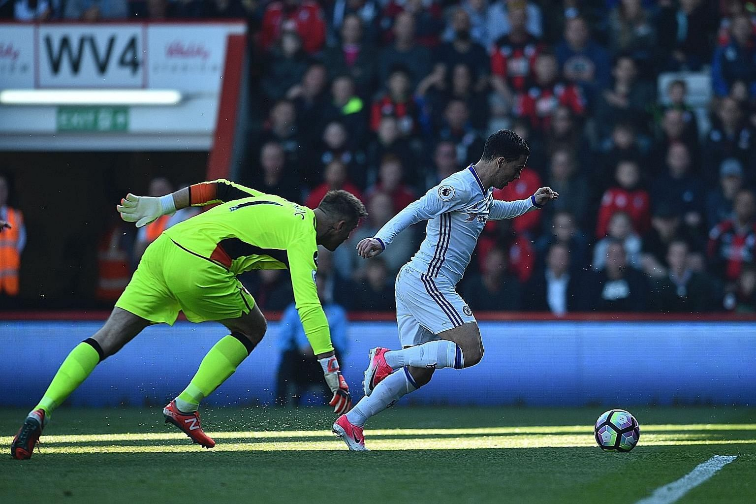 Chelsea midfielder Eden Hazard rounding Bournemouth goalkeeper Artur Boruc in the 20th minute to score their second goal. The Blues ran out comfortable 3-1 winners, and will next face Manchester United.