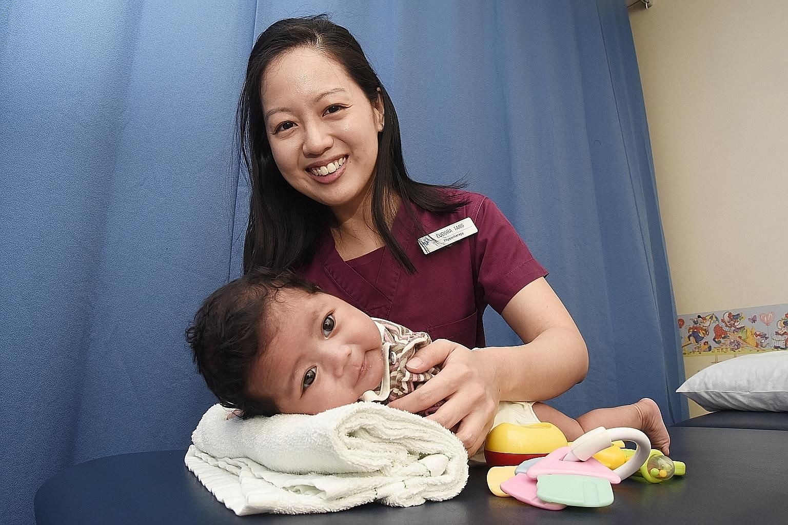 Ms Eudora Tang loves her work as she can provide relief to anxious parents and bring smiles to children.