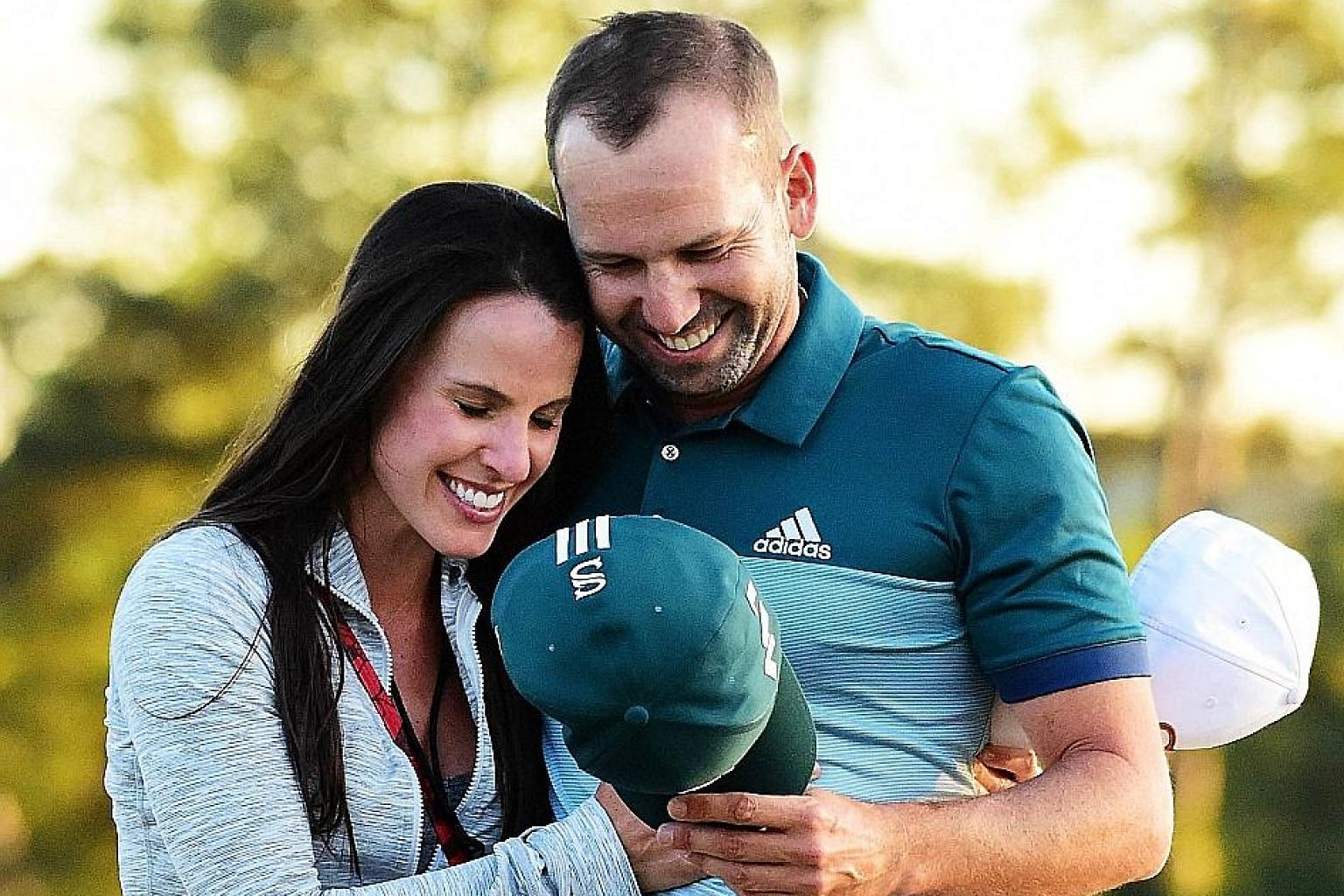 Sergio Garcia of Spain embraces fiancee Angela Akins after defeating Justin Rose to win his first Major. Akins, who will marry Garcia in July, left him a series of inspirational Post-It notes during the tournament.