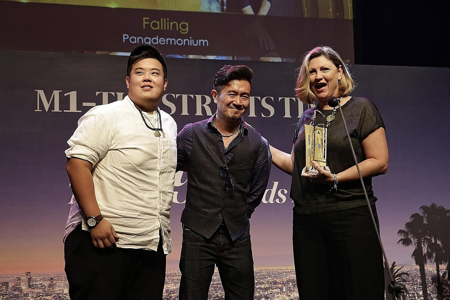Pangdemonium's (from far left) Andrew Marko, Adrian Pang and Tracie Pang receiving the Readers' Choice award for Production Of The Year for the play, Falling.