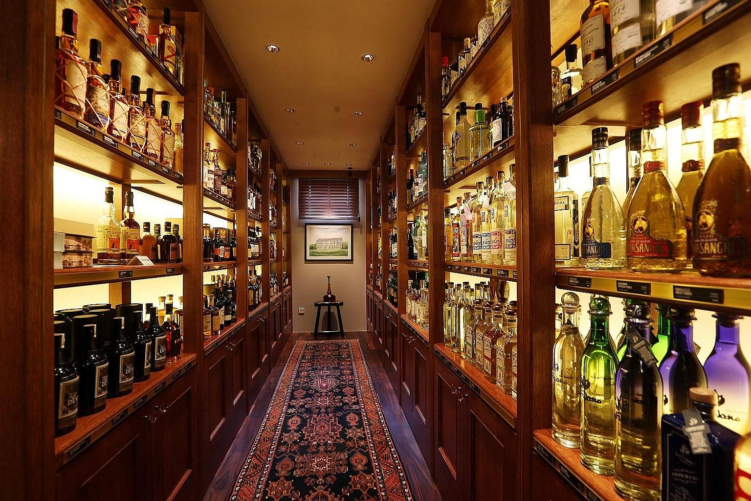 A hidden nook (above) behind a mirrored door is storage for alcohol bottles; the main retail area, which is styled like a living room; and a library with books on cocktails and spirits.