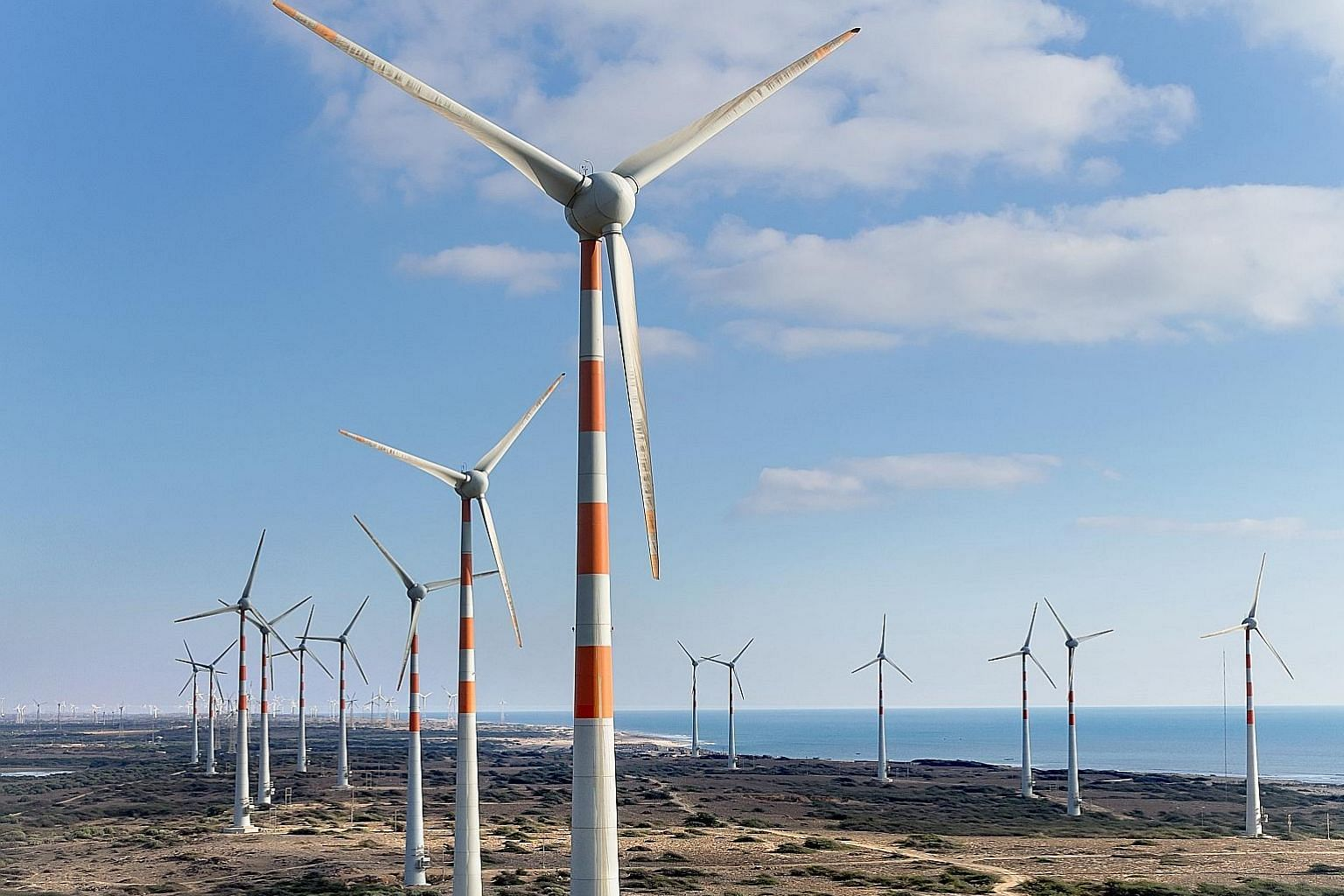Sembcorp Industries' wind turbines in India. The group is among a number of large Singapore firms to have made significant inroads into developing infrastructure across Asia.