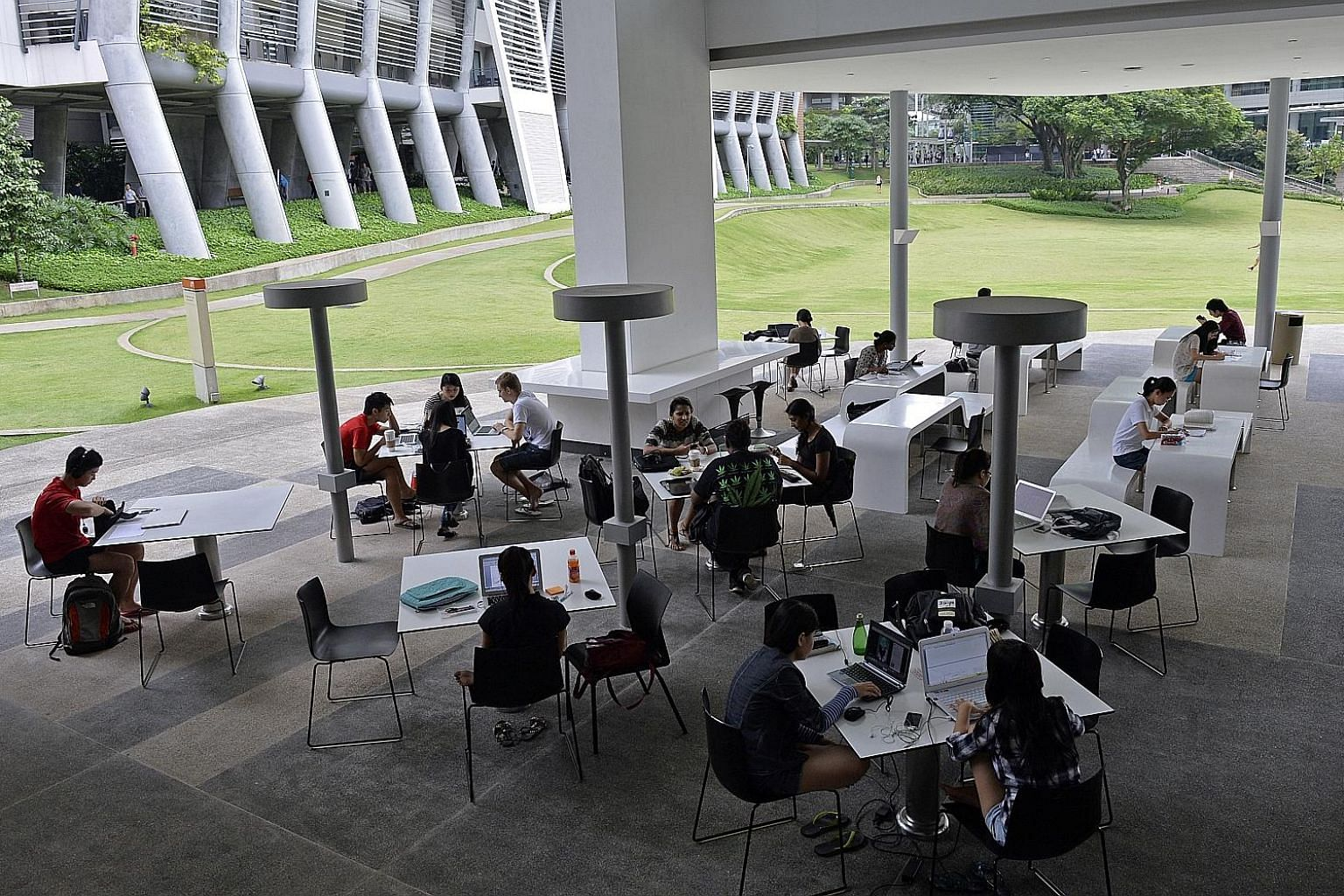 Students at NUS' University Town. Singapore's universities are now attractive partners for many of the top global varsities, but they are also tasked with educating the bulk of Singapore's tertiary students.