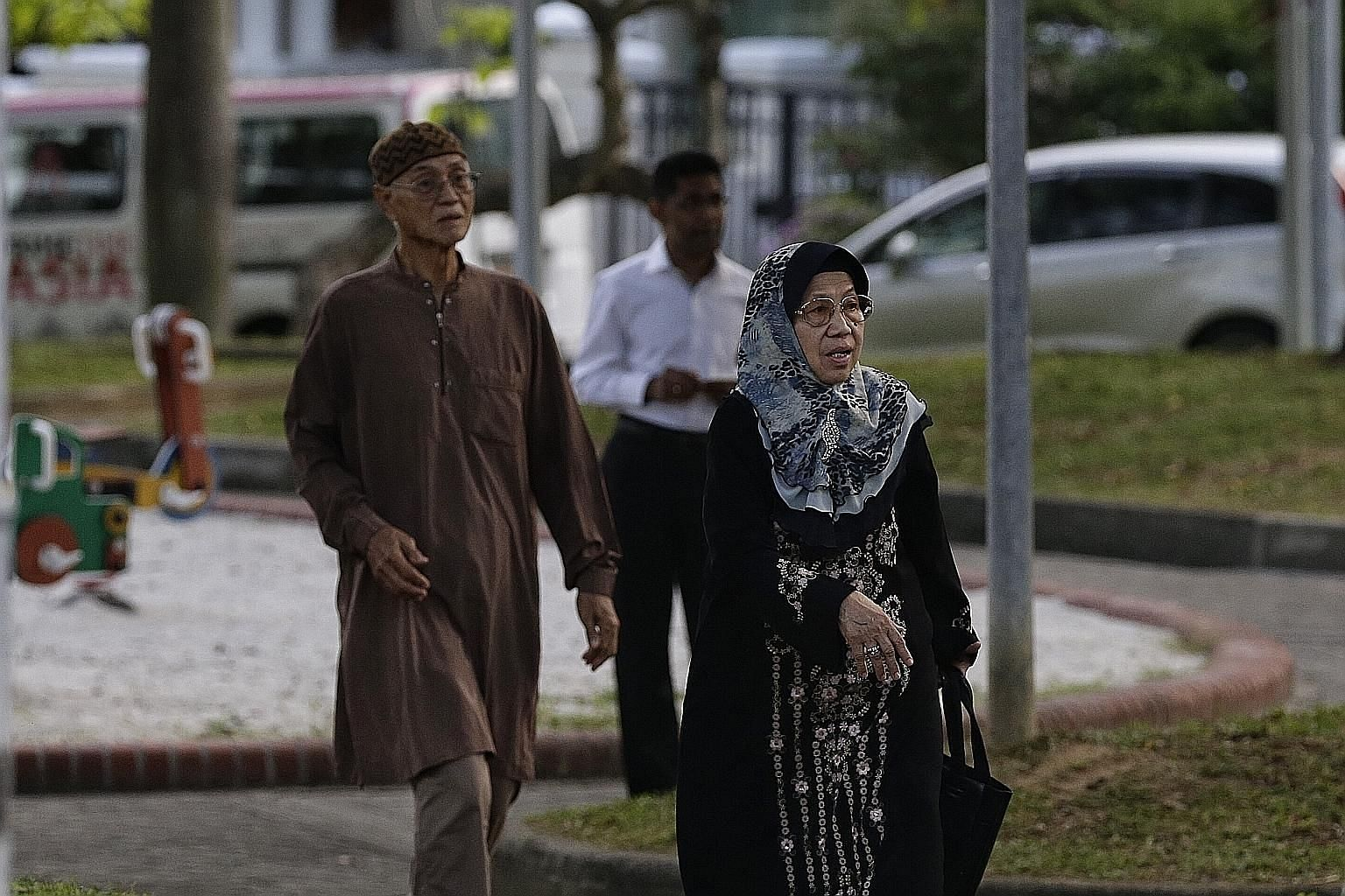 Mr Adanan Bakron and his wife Norsiah Suja'i were the first visitors to arrive at Mr Othman's home early yesterday morning to pay respects to their former neighbour and long-time friend.