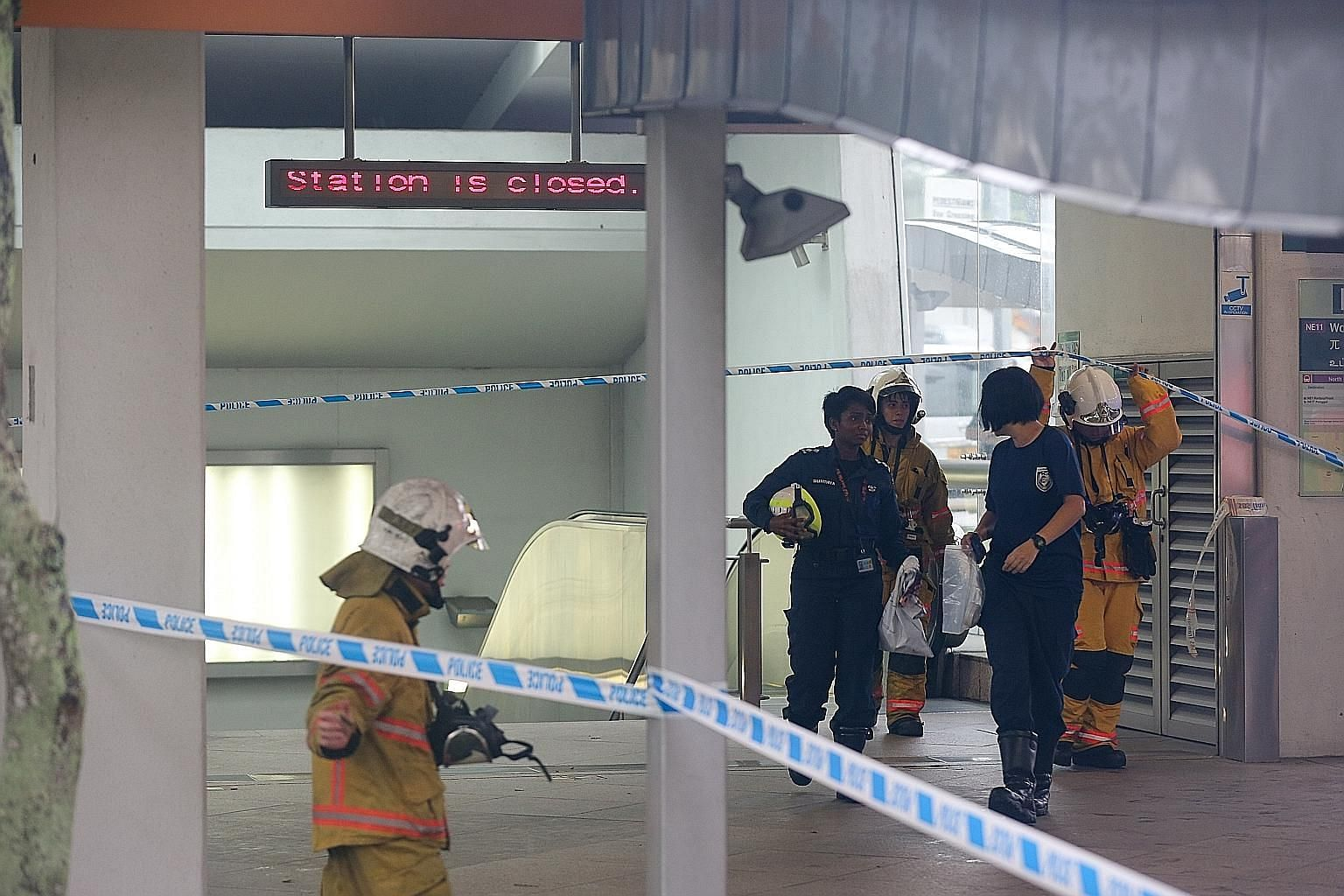 Singapore Civil Defence Force officers at Woodleigh MRT station yesterday, where the substance that later turned out to be flour was found at several spots.