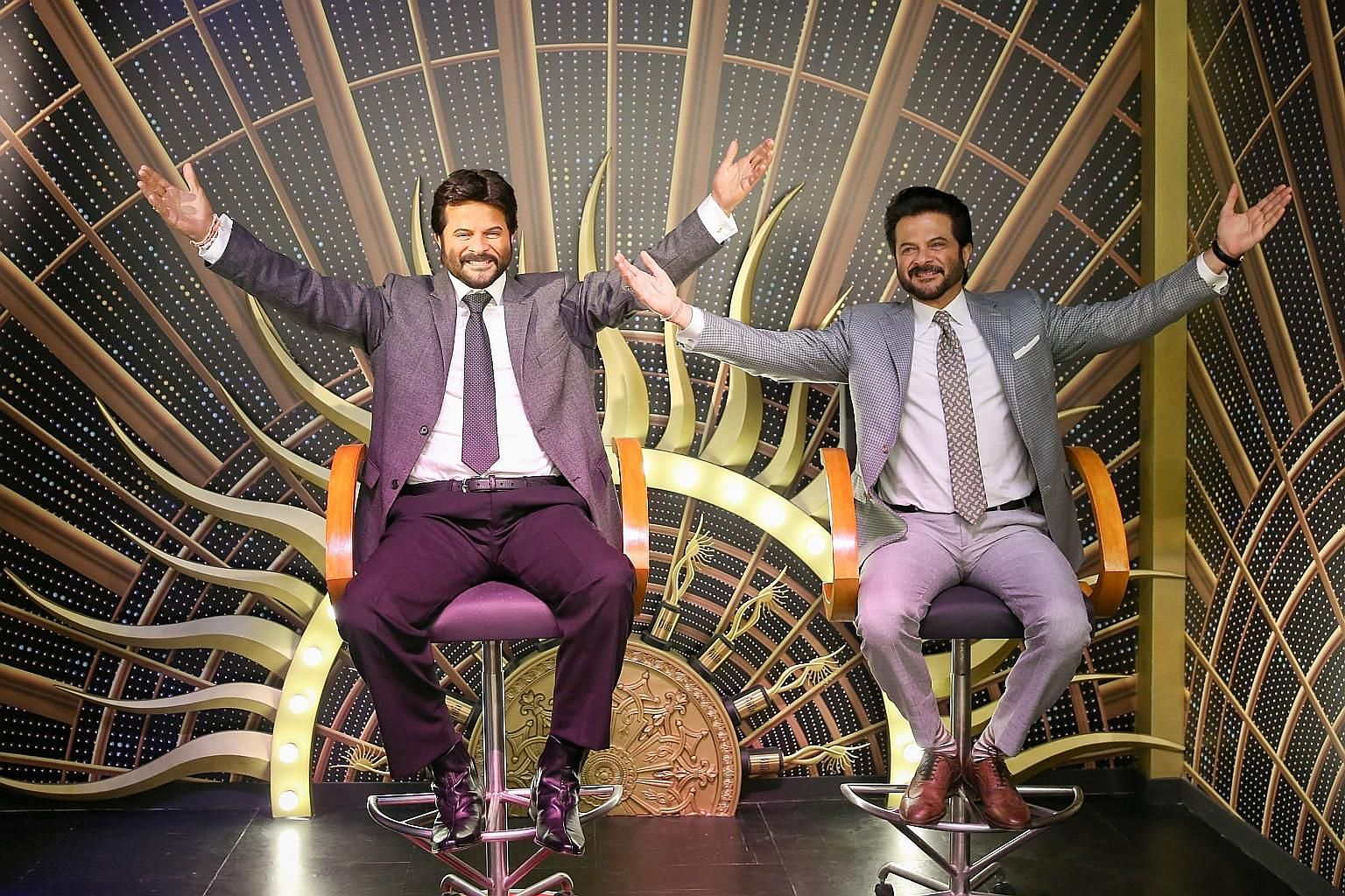 Bollywood star Anil Kapoor with a wax figure (left) of his character in Slumdog Millionaire.