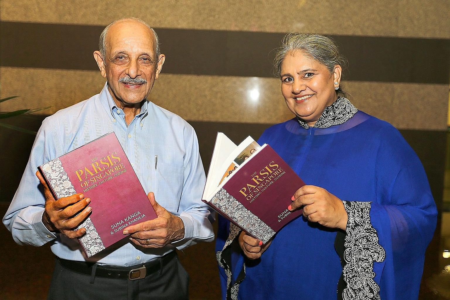 Mr Rustom Kanga with Mrs Subina Aurora Khaneja, who completed the book The Parsis Of Singapore, History, Culture, Cuisine. The book features photographs showing furniture and a picture of the sacred fire (far left) and a sace on a Chinese vase (left)
