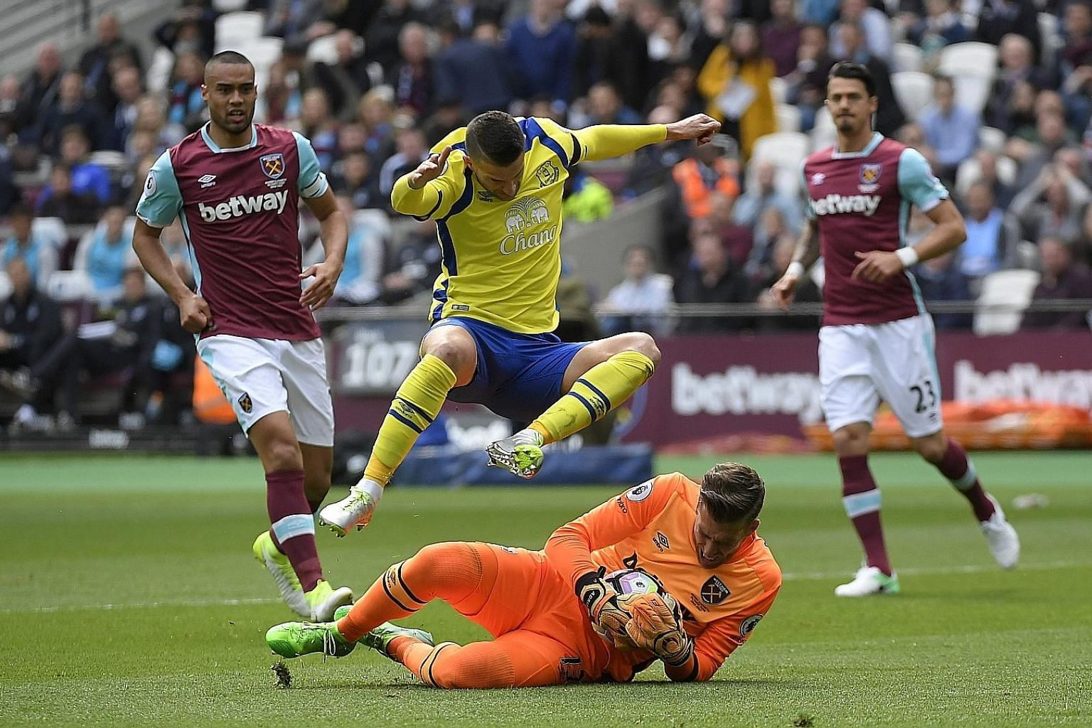 Everton's Kevin Mirallas leaps over West Ham goalkeeper Adrian as the latter makes a save. The Premier League match ended goalless, and puts a dampener on Everton's charge for a European spot.