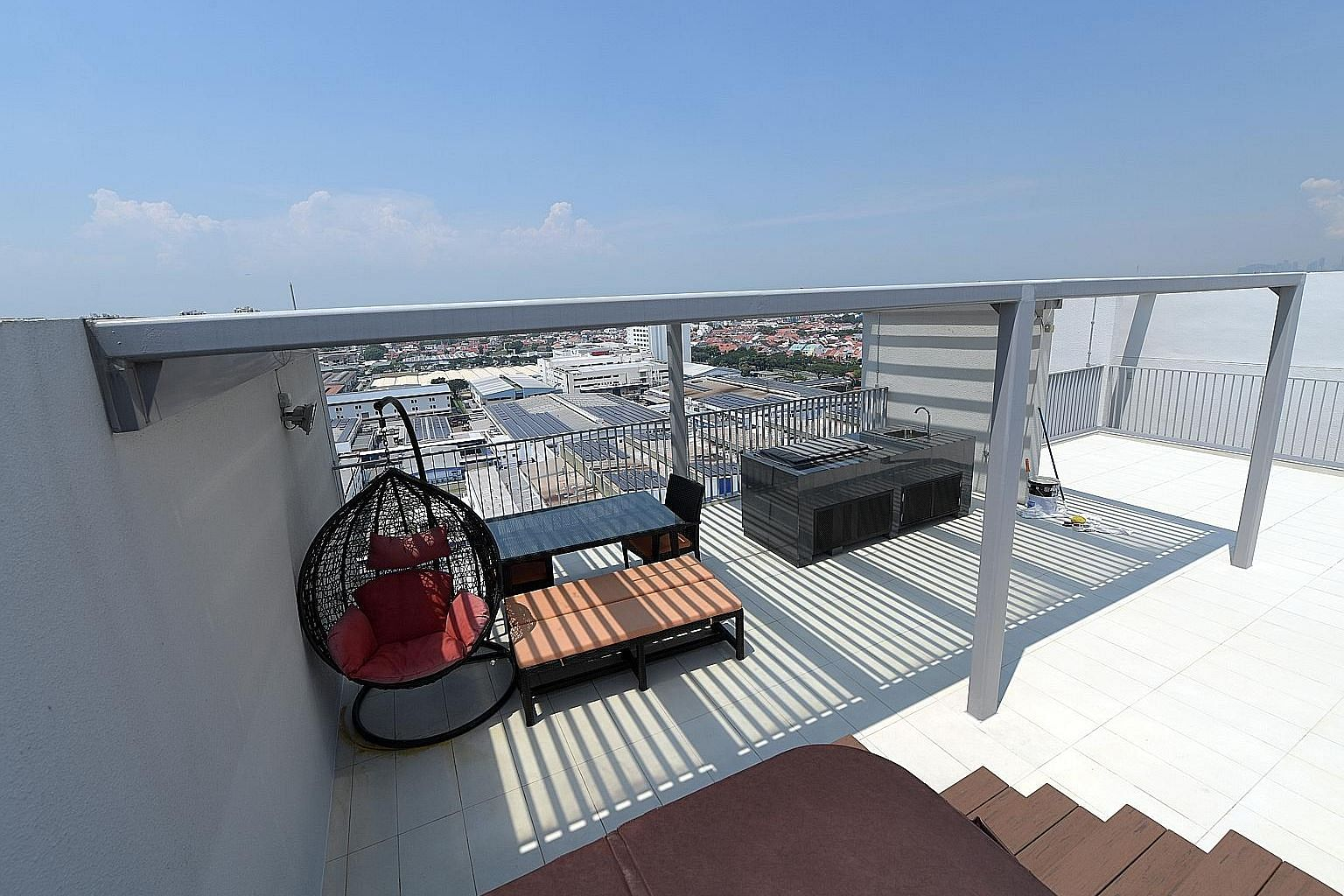 Some owners of penthouse units at condominium Bedok Residences have avoided using the barbecue pits and jacuzzis on their private roof terraces when they saw that the lightning rods connect to the metal rails and facades of the units (above right). H