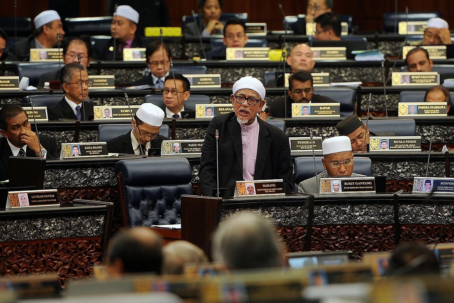 PAS president Abdul Hadi Awang tabling amendments to the Syariah Courts (Criminal Jurisdiction) Act in the Malaysian Parliament on April 6. The Speaker abruptly ended proceedings without allowing dissenting debate or a vote.