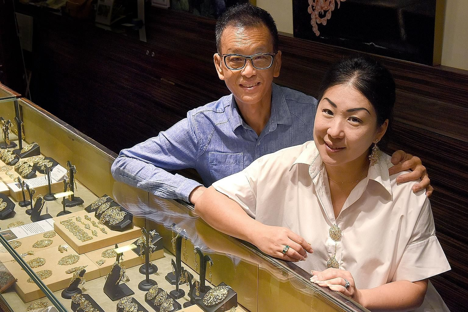 Mr Thomis Kwan focuses on the design and production of his company's Peranakan-style jewellery while his wife, Ms Caroline Tay (both above), handles sales and customer service.