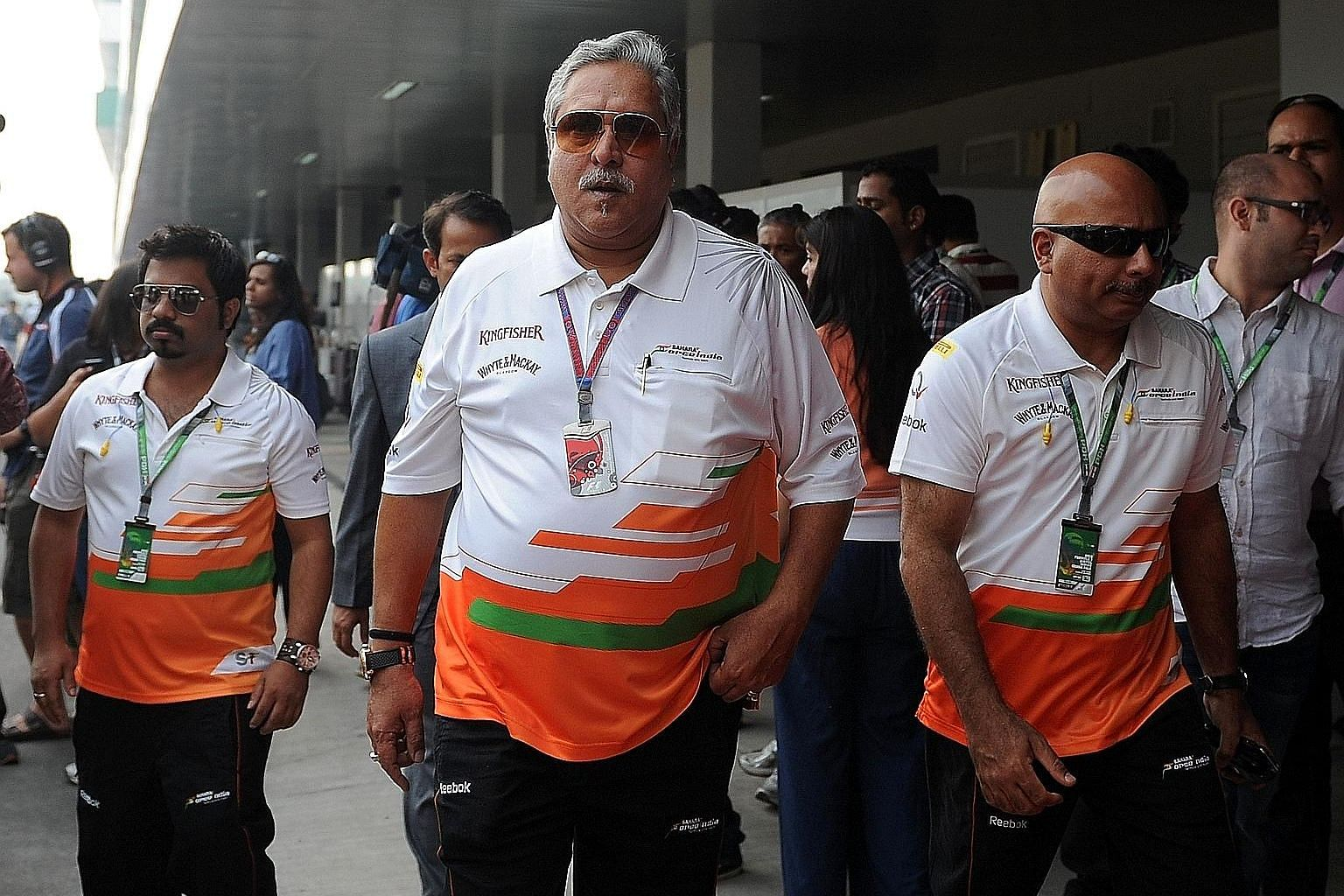 Kingfisher Airlines founder Vijay Mallya (centre) at a 2012 Formula One event. Last week, he was arrested by Scotland Yard and then released on bail in what the Indian authorities said was the beginning of extradition proceedings.