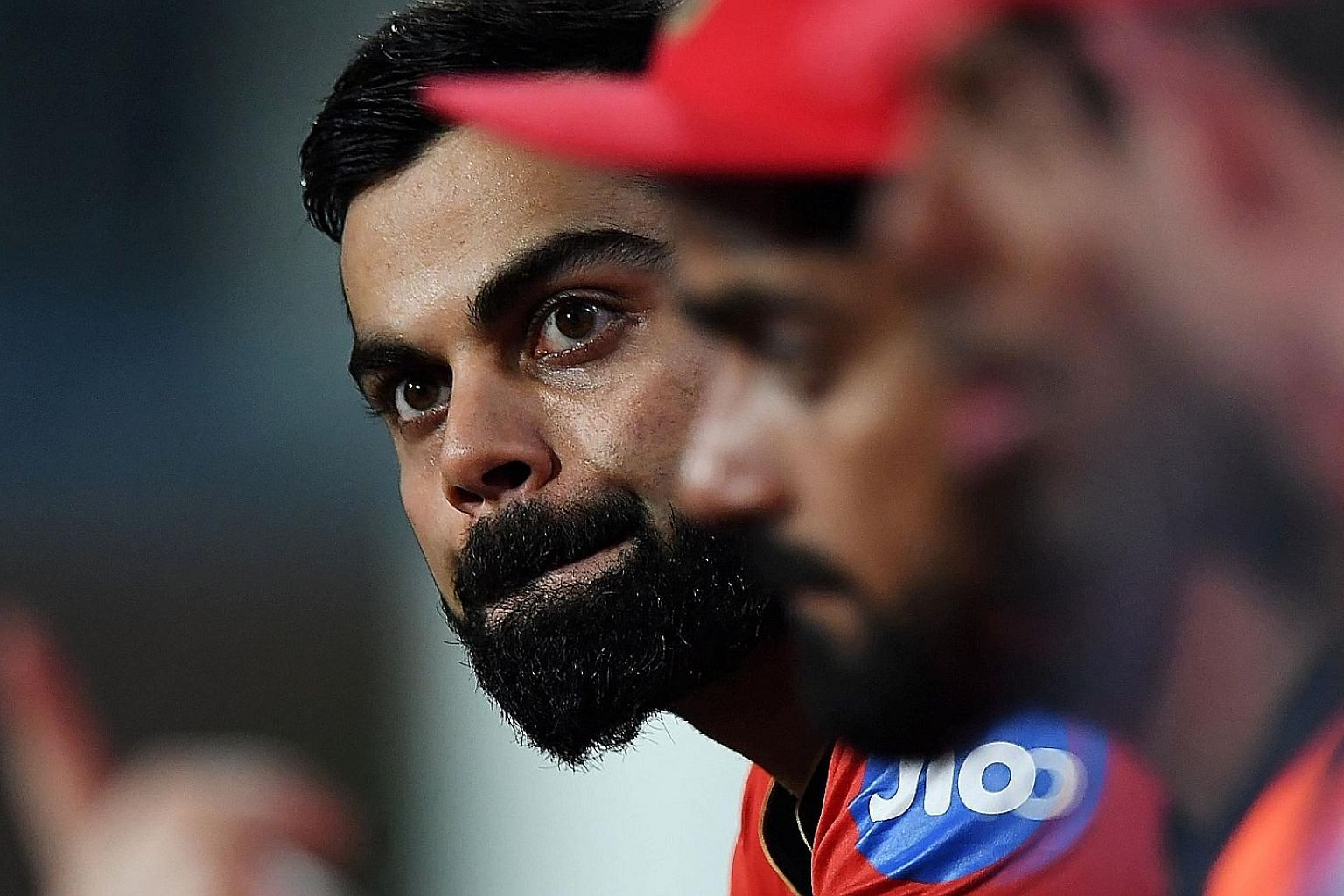 Royal Challengers Bangalore captain Virat Kohli watching his team slump to an IPL-record total of just 49. The powerful batting line-up lasted just 58 deliveries.