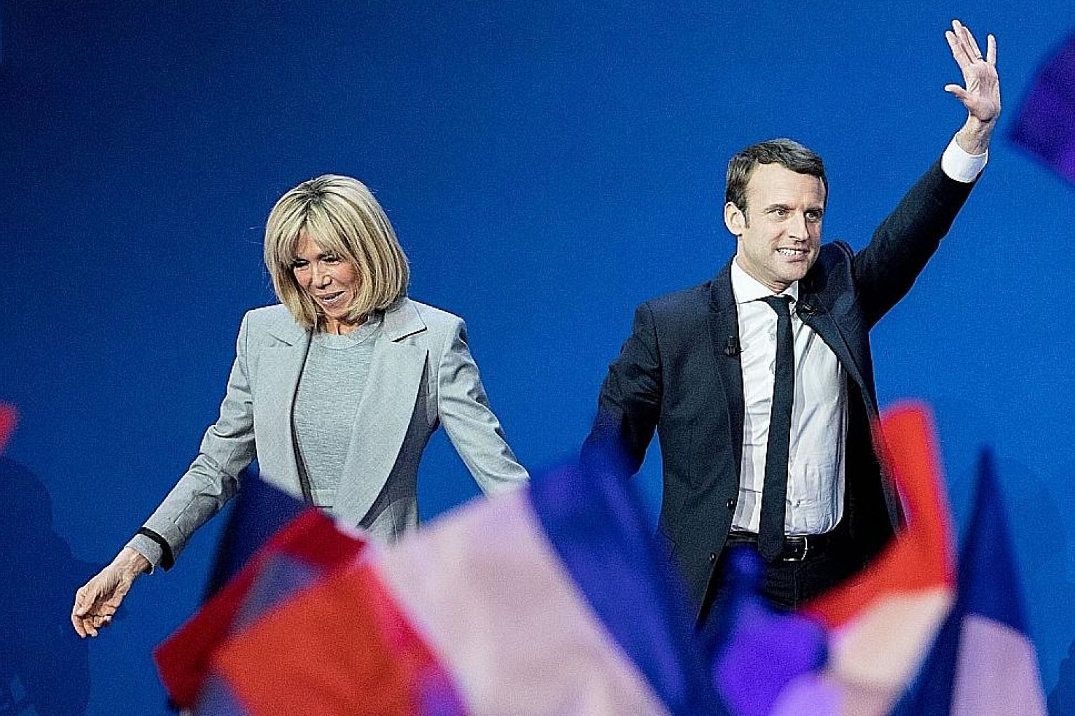 Presidential candidate Emmanuel Macron and his wife Brigitte Trogneux arriving at Parc des Expositions in Paris, France, on Sunday to deliver a speech after the first round of voting in the election.