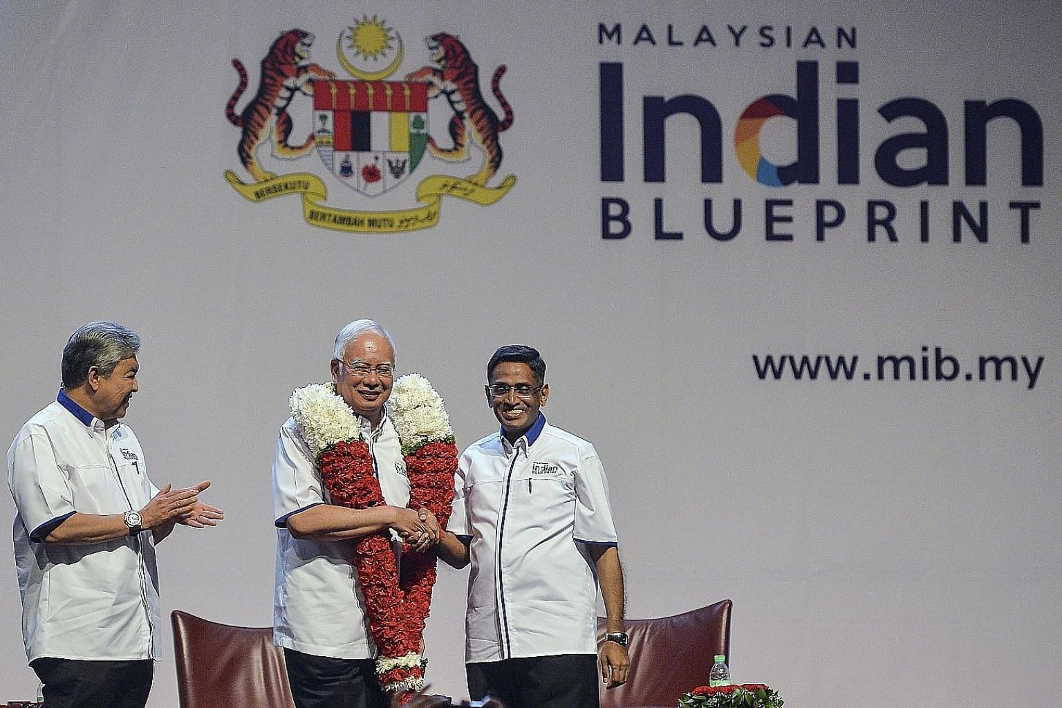 Malaysian Prime Minister Najib Razak flanked by MIC president S. Subramaniam (right) and Deputy Prime Minister Ahmad Zahid Hamidi at the announcement of the blueprint for the country's Indian community on Sunday.