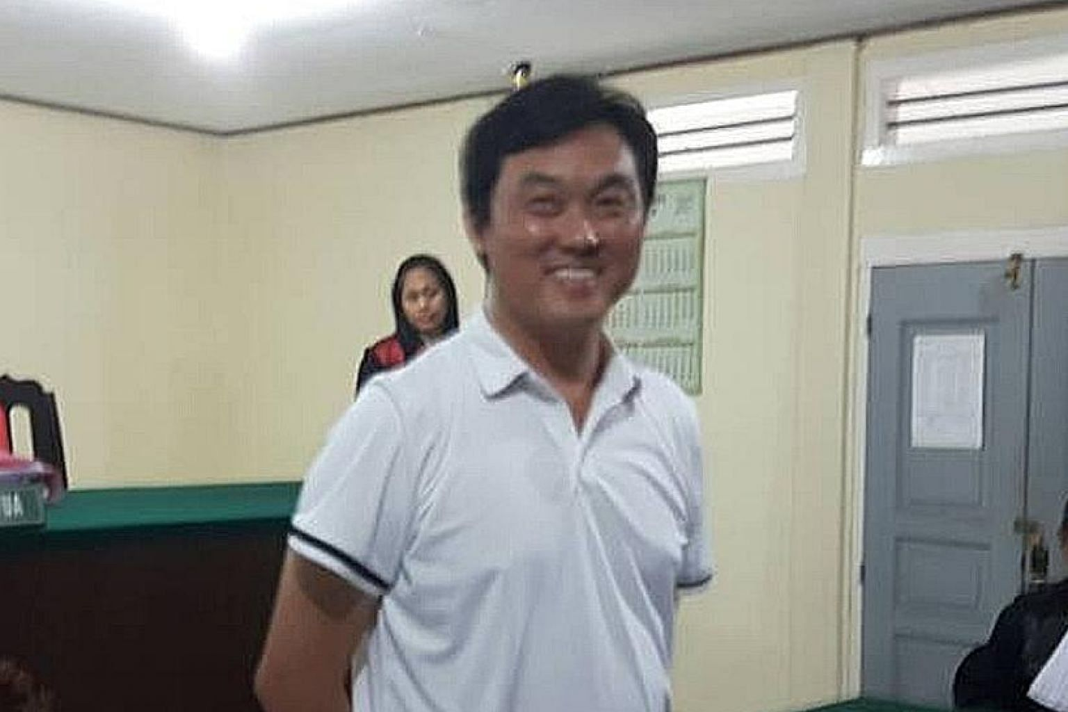 Boat captain Ricky Tan pleaded guilty to trespassing in Indonesian waters and was sentenced to six months' probation and fined 5 million rupiah (S$520) yesterday.