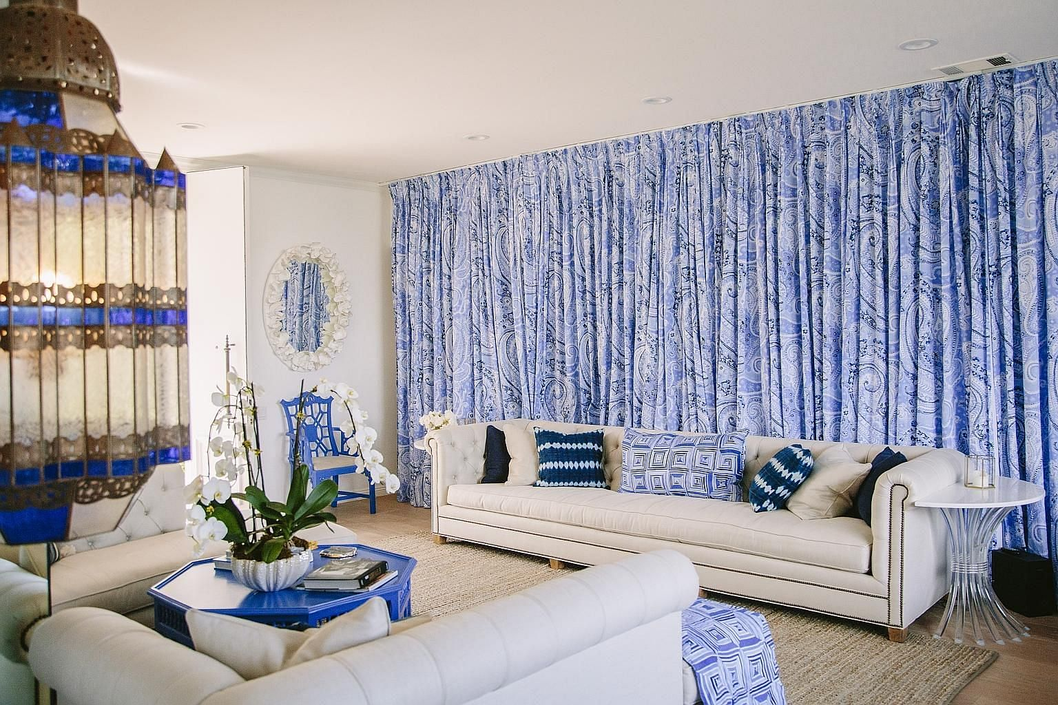 A Palm Desert home (above), which still features the original lime-green and white scheme (above) of its 1971 decor; and a room in another home, decorated with blue paisley-print drapes (left). A poodle-cut tree in the Marrakesh residential community