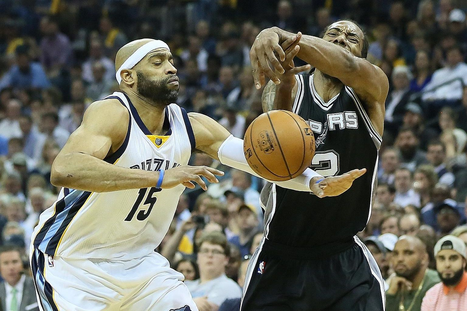 San Antonio Spurs' Kawhi Leonard has the ball knocked loose from his grip by the Memphis Grizzlies' Vince Carter. The Spurs forward led all scorers with 29 points as San Antonio put Memphis to rest 103-96, setting up a Conference semi-final showdown