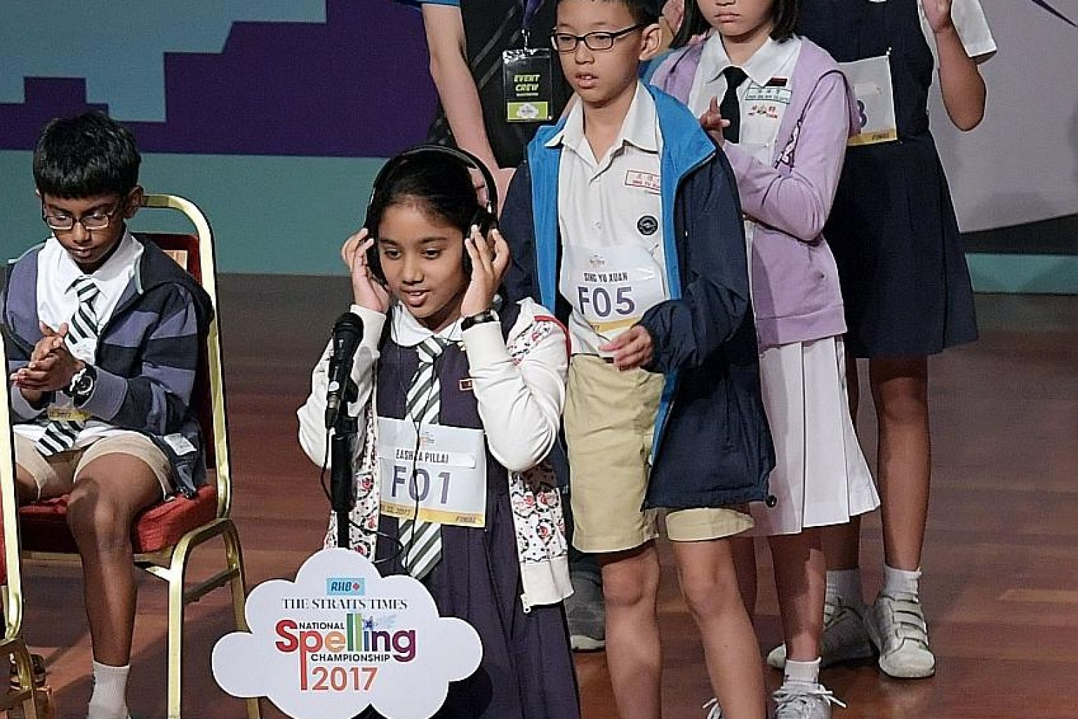 Competitors during the final round of the RHB-The Straits Times National Spelling Championship. Those who got knocked out in the earlier rounds remain in a holding area so they can be more easily recalled if there is a tussle for a lower-ranked spot.