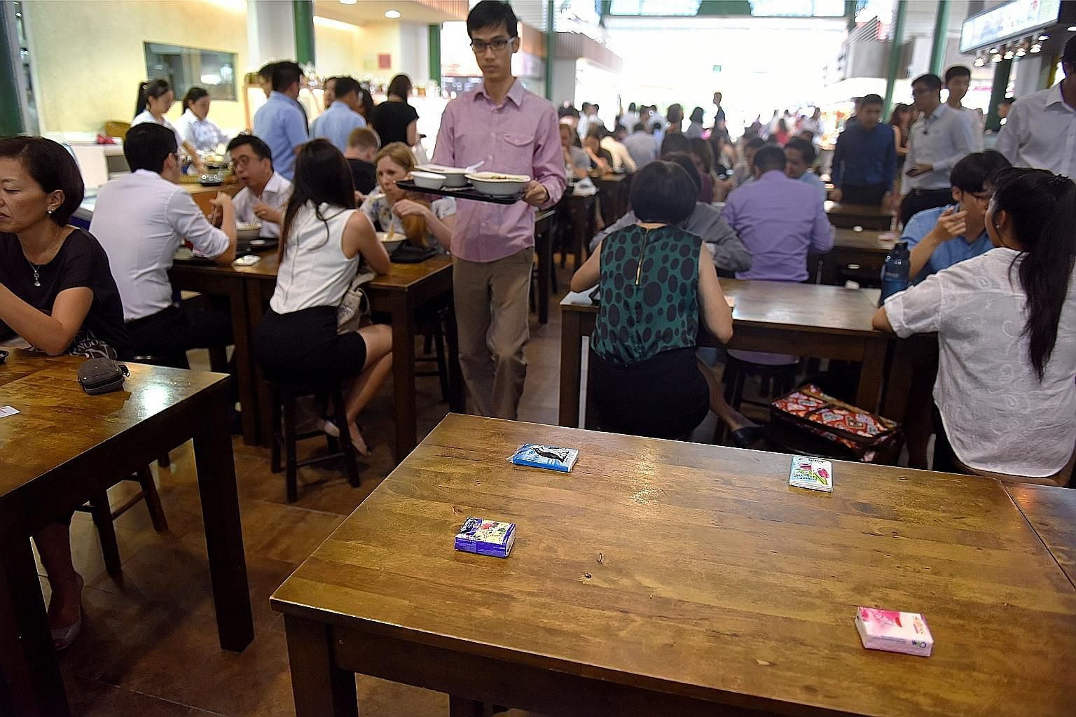 Although there are no restrictions on using items such as tissue paper to reserve seats in hawker centres, the National Environment Agency urged patrons to exercise consideration.