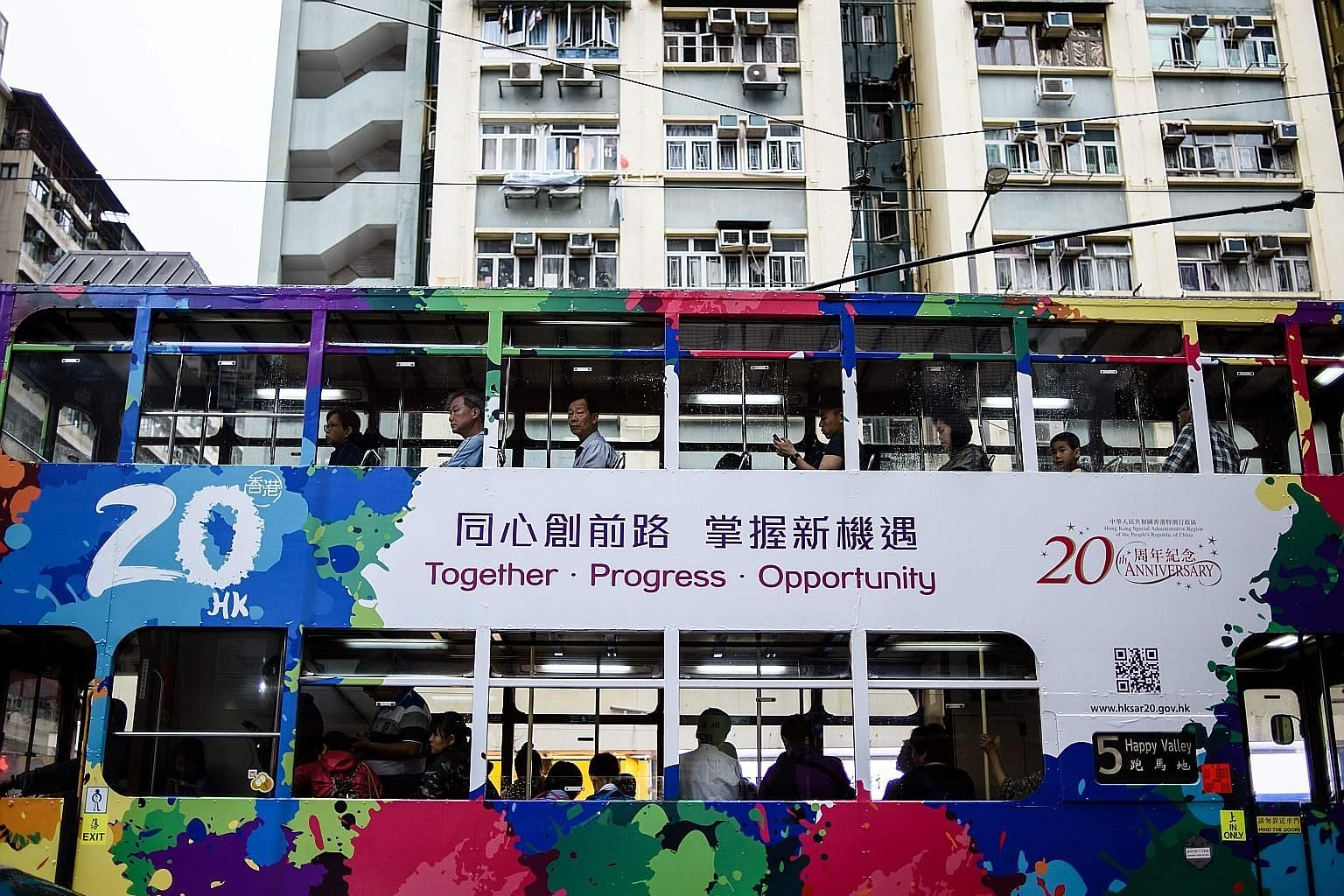 A tram in Hong Kong adorned with artwork commemorating the 20th anniversary of the city's handover to China by Britain. Chinese President Xi Jinping is expected to visit the city for the July 1 anniversary, his first trip there since coming to power