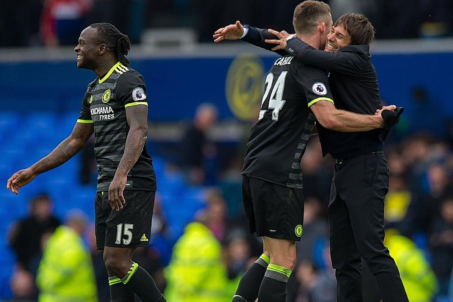 Smiles all around as Chelsea manager Antonio Conte (right) congratulates Gary Cahill (centre) and Victor Moses after their 3-0 victory over Everton at Goodison Park. The hard-fought win means they have beaten the most difficult team left in their sea