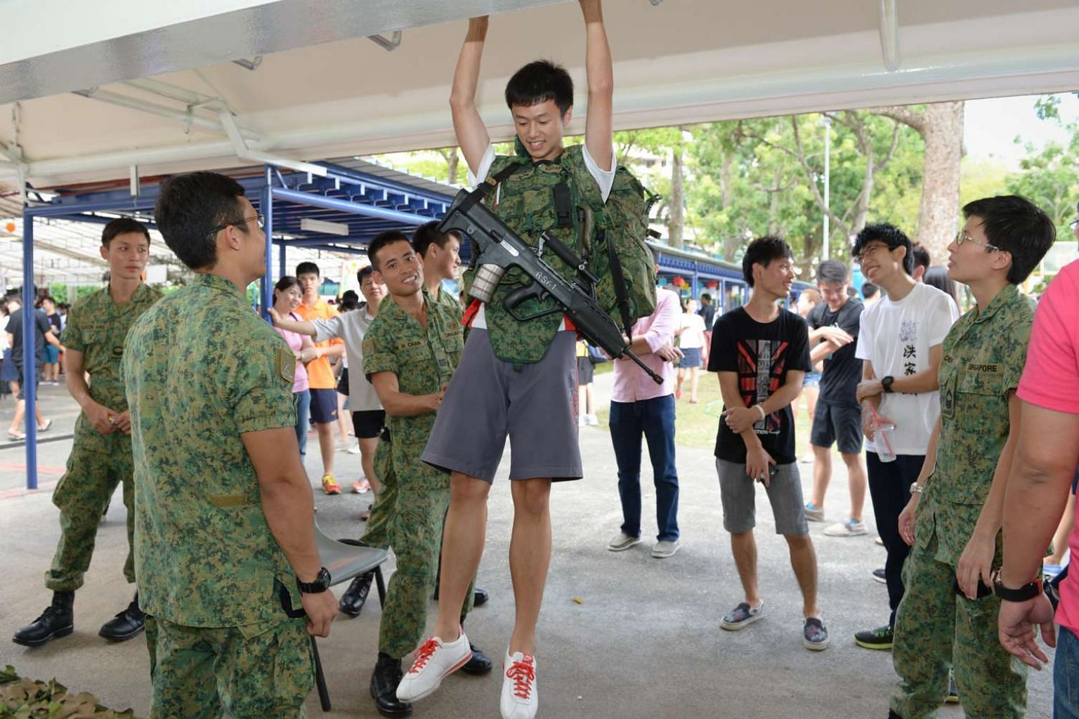 A pull-up challenge at a booth set up by the Singapore Artillery during Yishun JC's annual Celebrating Values Day. Yishun and Innova JCs, which will be merged, are committed to authentically and meaningfully preserving the heritage of both colleges.