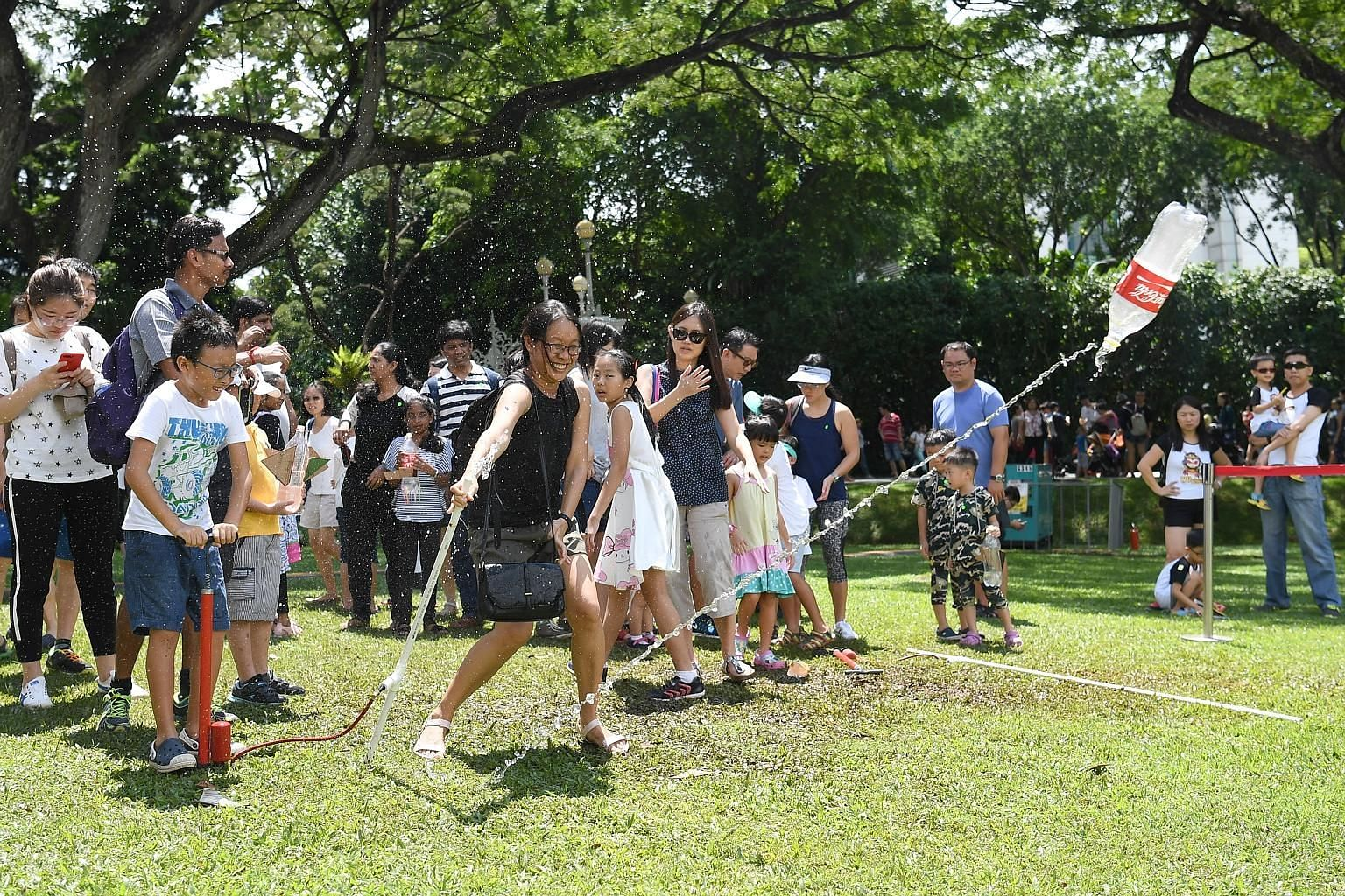 Clear skies and sunny weather greeted visitors to the Labour Day celebration at the Istana yesterday. Among the activities they got to enjoy was one involving firing rockets improvised from plastic bottles.