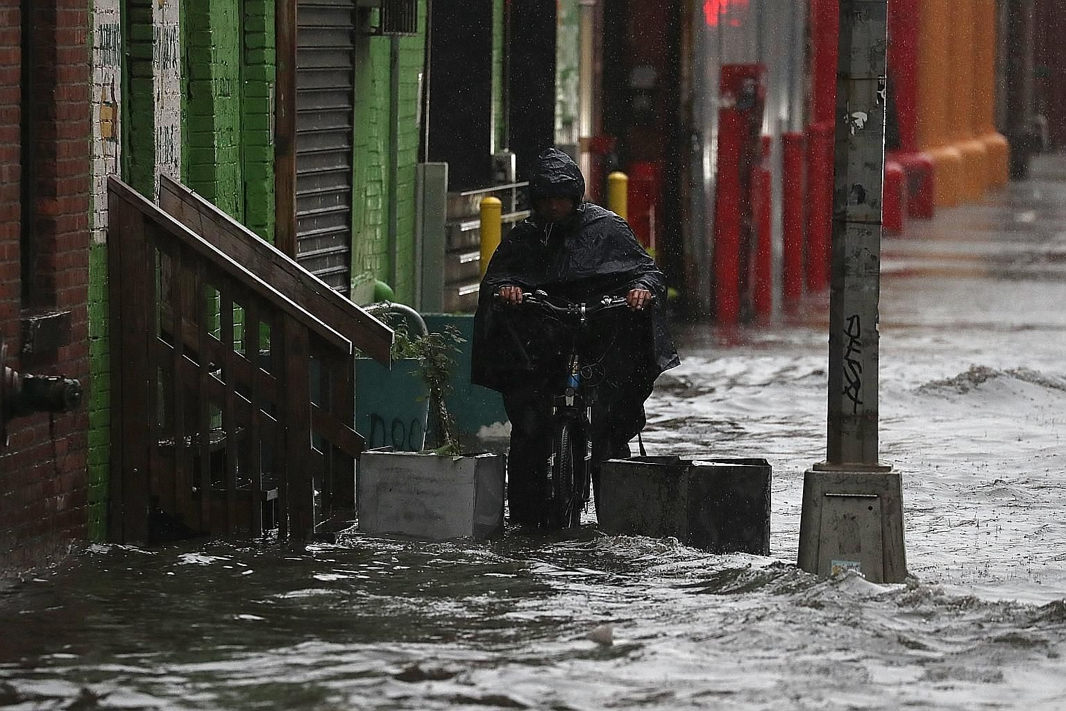 A flooded street in Brooklyn, New York, on Friday. Mr Donald Trump had promised to cancel the Paris Agreement on climate change during his presidential campaign. He has since said he will decide on the deal before the G7 meeting later this month.