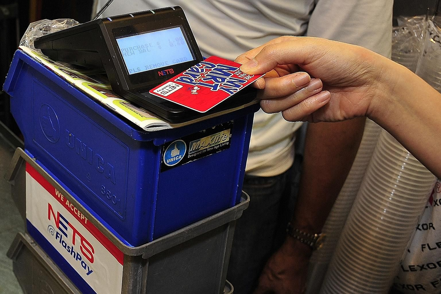 A stall offering cashless payment often has to operate several different payment devices, creating a cost burden. To offset costs, the National Environment Agency and Spring Singapore provide grants for digital service solutions.
