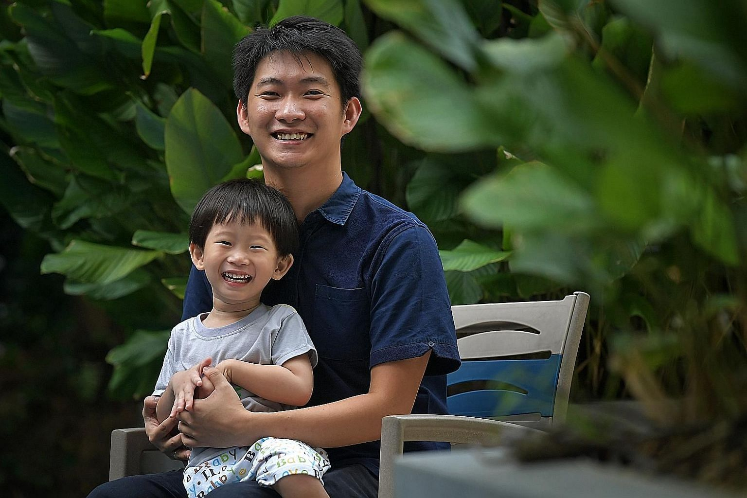 Singapore permanent resident Brian Halim, seen here with his three-year-old son Oscar, is a financial controller for a logistics company. He started investing in stocks when he was 24 and favours those on the Singapore Exchange that suit his risk app