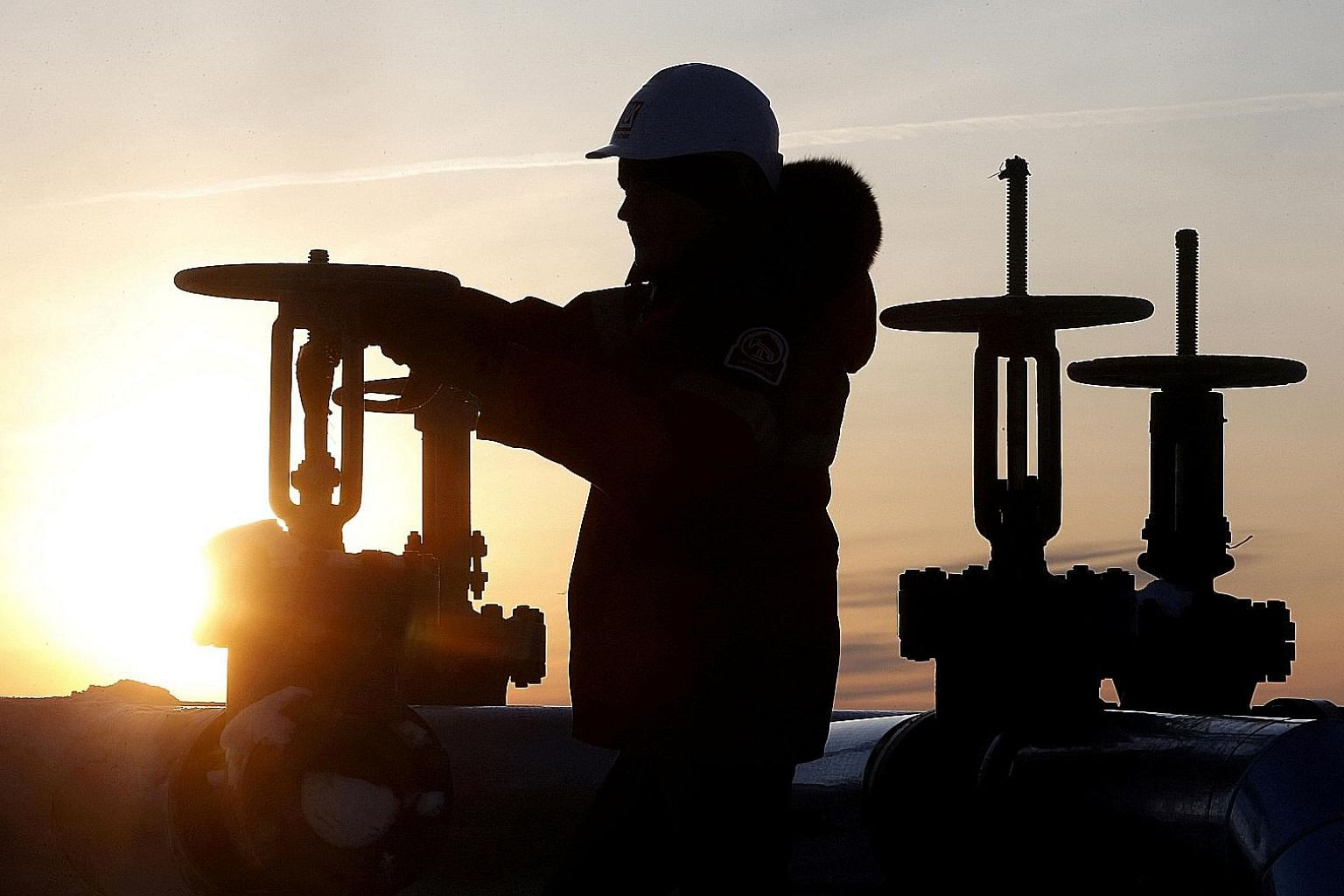 An oil pipeline owned by Russian company Lukoil near Kogalym in Russia. Opec, of which Saudi Arabia is the de facto leader, and other producers, led by Russia, pledged last year to cut output by 1.8 million barrels per day during the first half of th