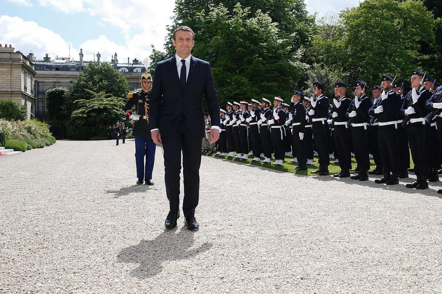 "French President Emmanuel Macron reviewing troops in the gardens of the Elysee Palace in Paris, following his inauguration on Sunday. France's adoption of open party primaries saw its two main parties choosing ""hard-left"" and ""hard-right"" candidates,"