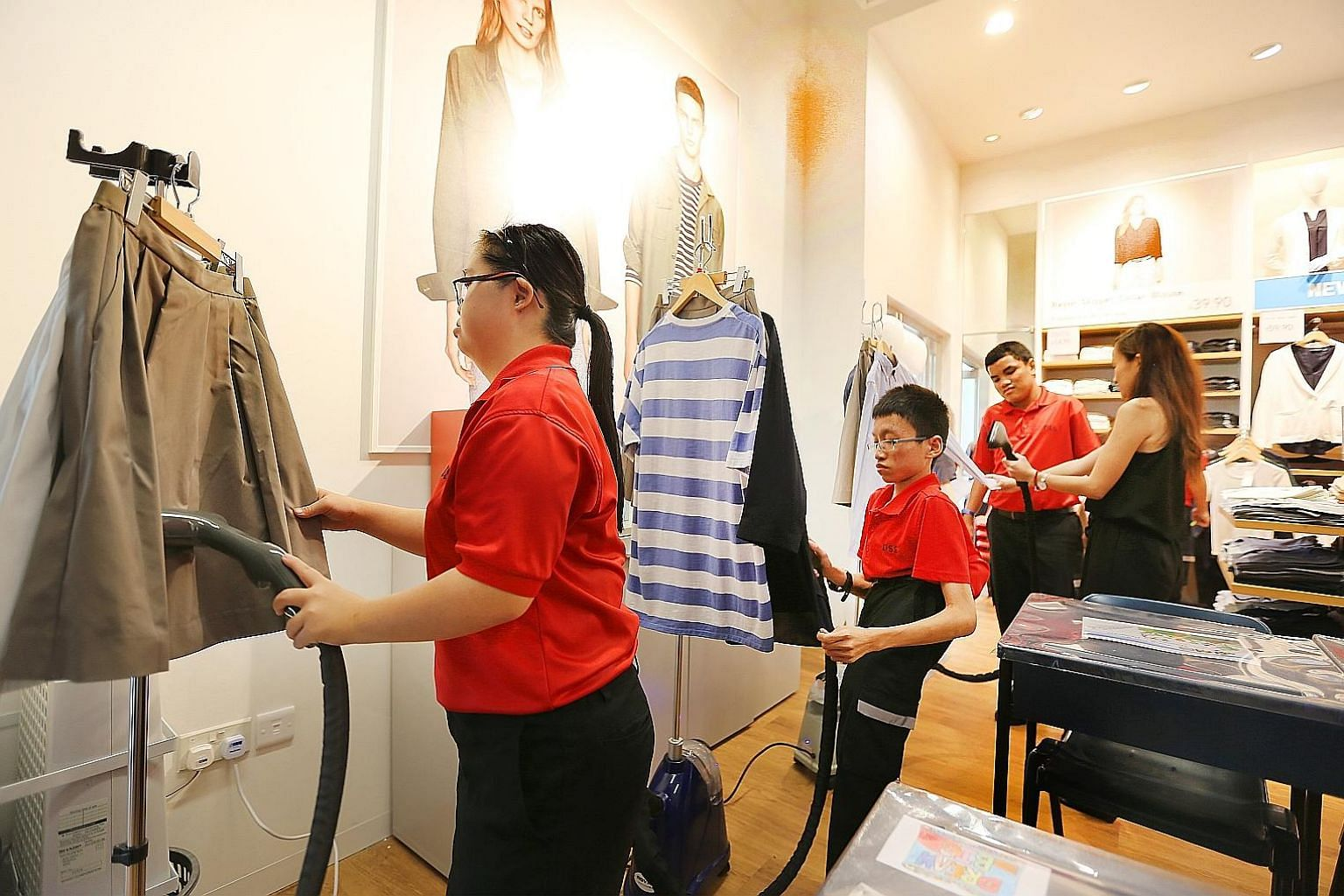 At Retail@DSS, students learn how to fold and arrange clothes, iron them with a clothes steamer, and manage the fitting room, among other tasks.