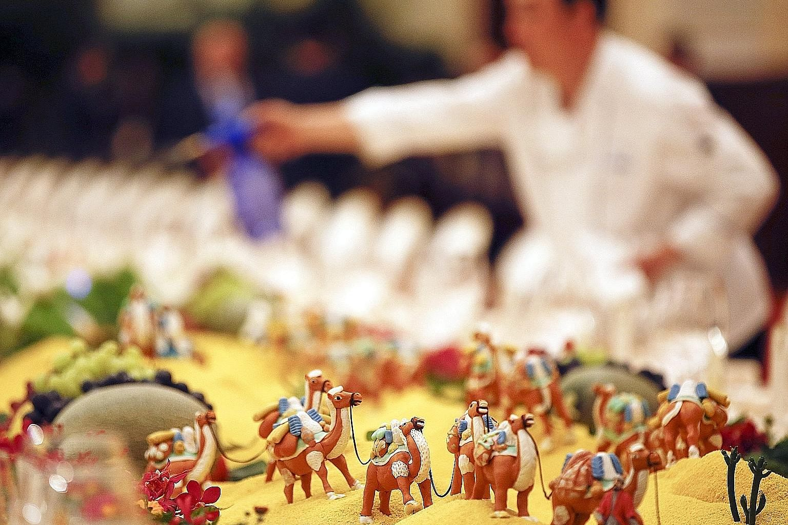 """The set-up at Beijing's Belt and Road Forum welcome banquet this week included food sculptures of camels that plied the Silk Road. At the forum, President Xi Jinping said China would """"foster a new type of international relations"""" based on mutual coop"""