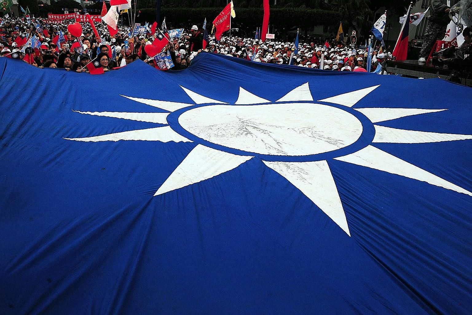 This picture, taken on Jan 8, 2012, shows a Kuomintang flag on display at an election campaign rally in Taipei. The party vowed to reform after a crushing defeat in elections last year, but it is still struggling to find its feet.