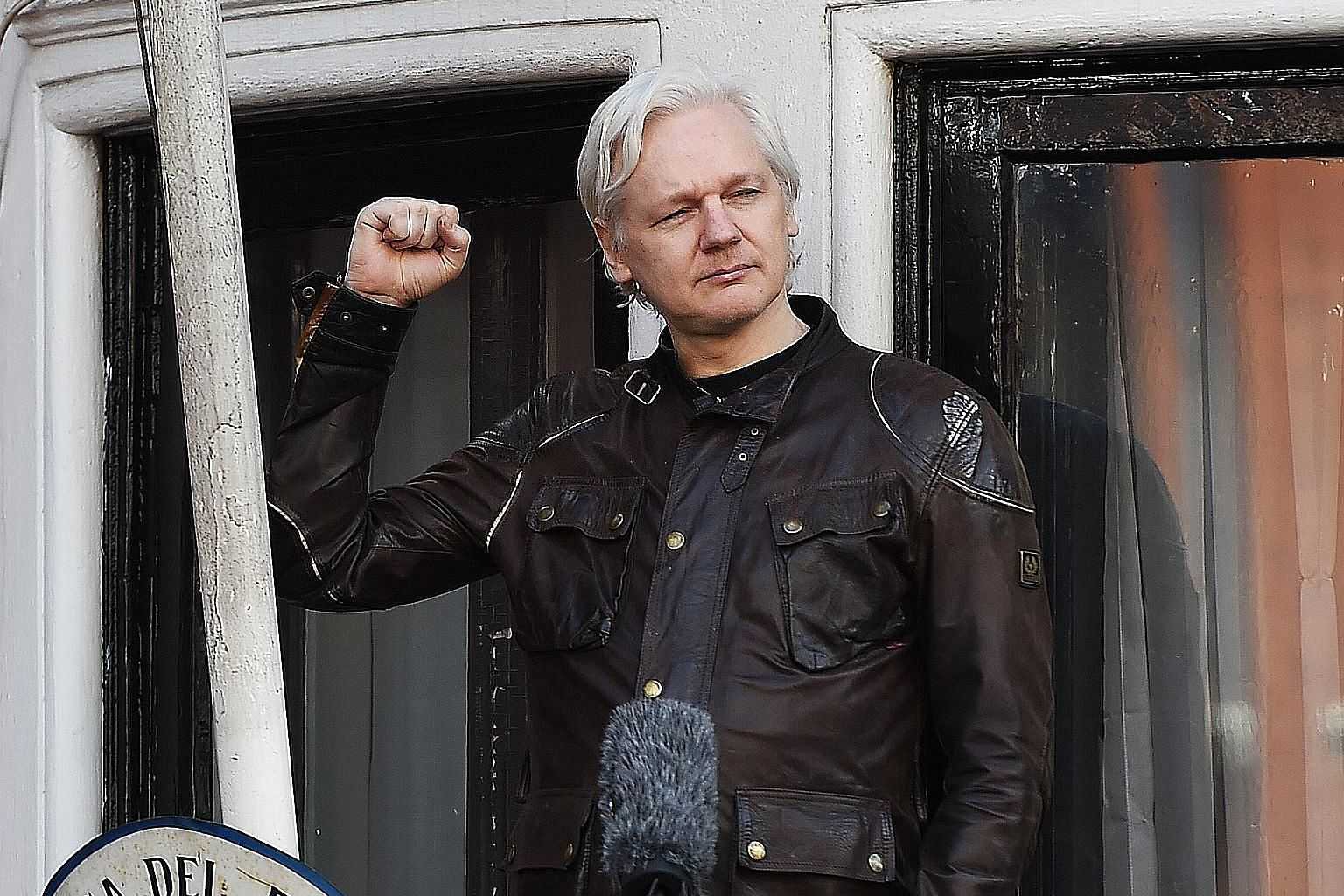 WikiLeaks founder Julian Assange speaking to the media from the balcony of Ecuador's London embassy, where he has been holed up since 2012. British police could arrest him for breaching earlier bail conditions if he leaves the building.