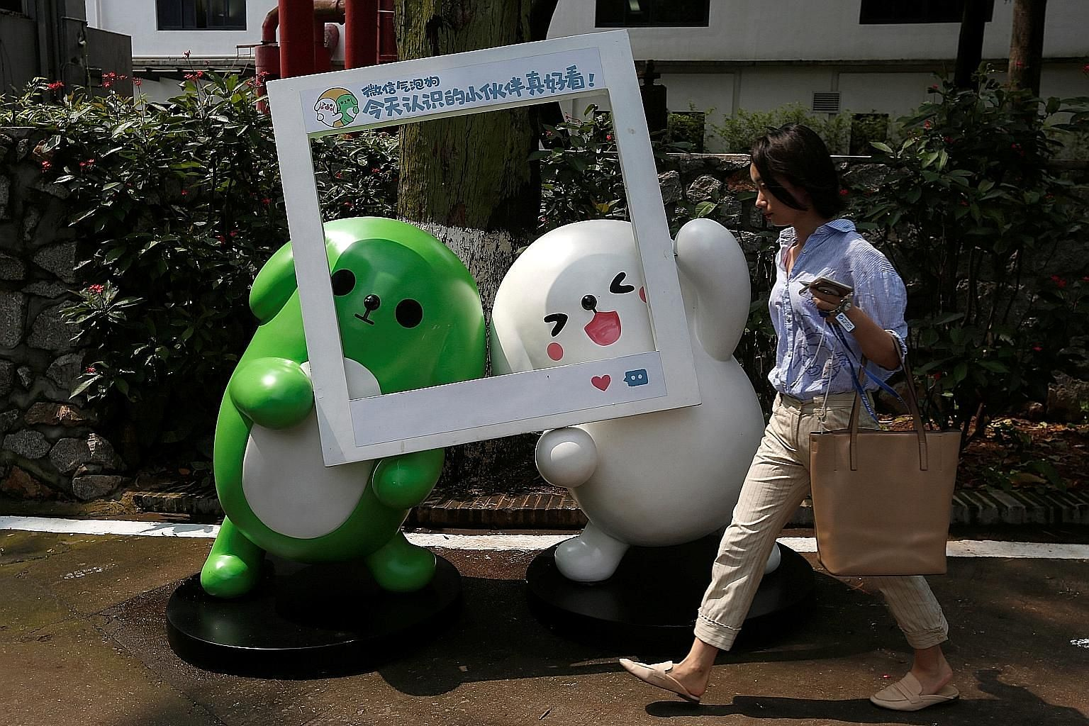 Mascots of Tencent's mobile chat service WeChat inside Guangzhou's TIT Creativity Industry Zone. With a market value of over $460 billion, Tencent is now worth almost half as much as all the companies listed on the Singapore Exchange, even though it