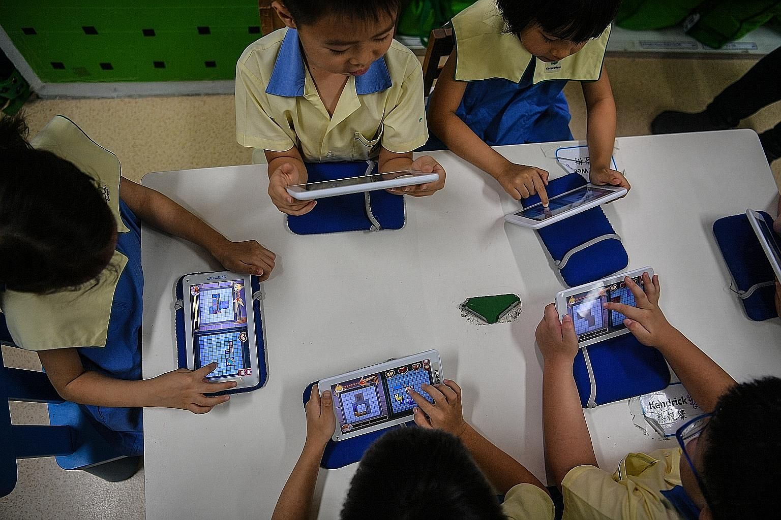 Children at Carpe Diem Juniors playing the Manta Match Mania game on the School of Fish app, developed by education firm Jules Ventures for use in pre-school settings. They spend an hour each week on the curriculum, playing games and reviewing what t