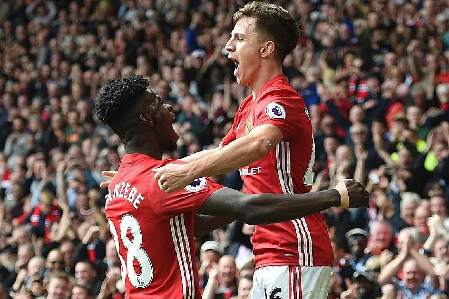 Josh Harrop celebrates scoring on his Manchester United debut against Crystal Palace with Axel Tuanzebe. Harrop, 21, was one of four players Jose Mourinho gave their first starts in a United shirt to.