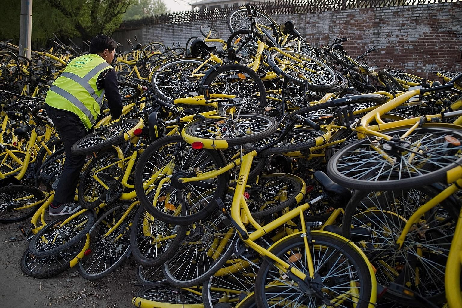A pile of Ofo bicycles at a repair centre in Beijing last month. Some 30 bike-sharing companies have placed over three million bikes on streets around China, according to state media.