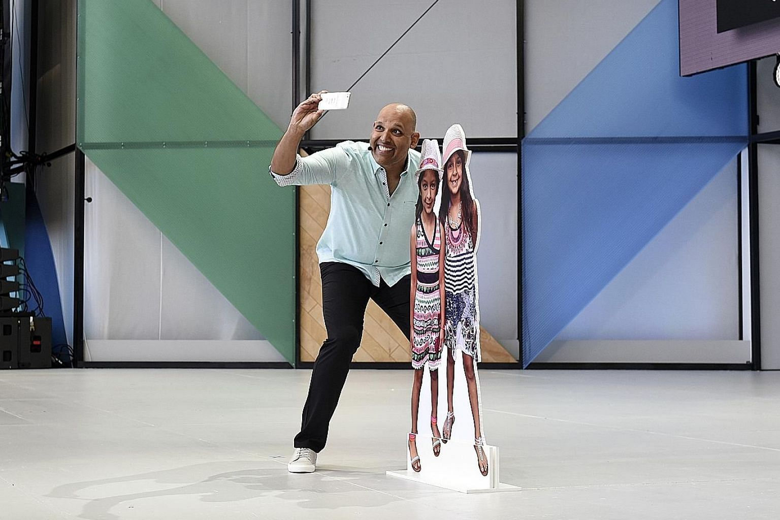 Google Photos vice-president Anil Sabharwal demonstrating a product using a smartphone and props during the Google I/O Annual Developers Conference in California last Wednesday. Google's artificial intelligence software will make its presence felt mo