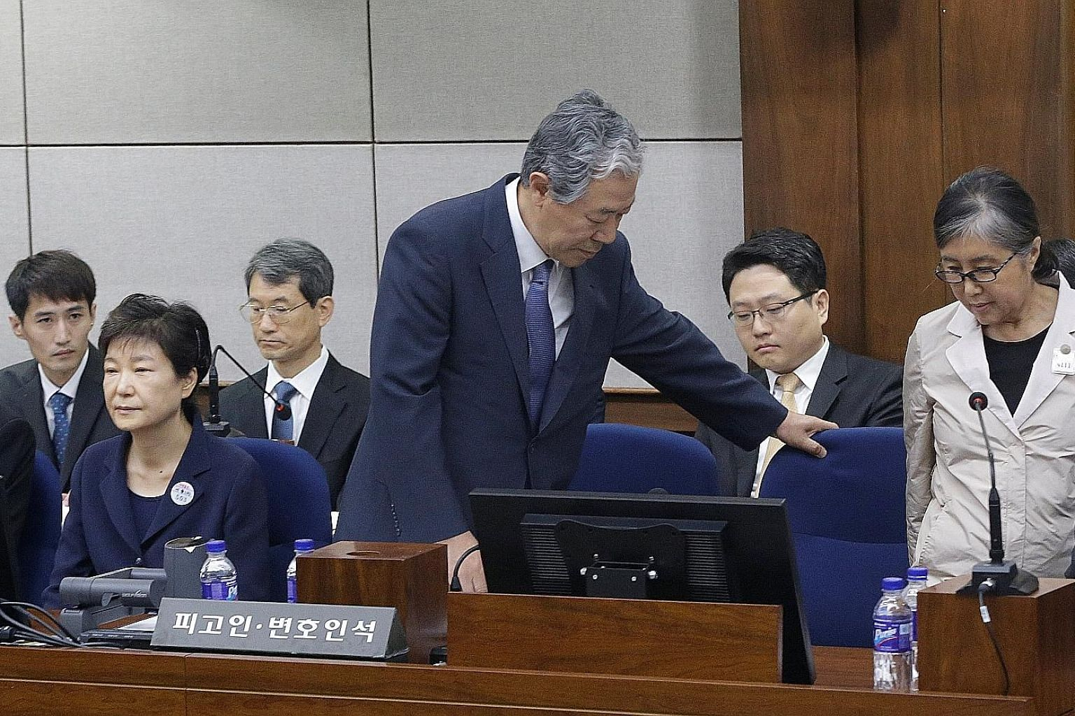 Park arriving for the trial yesterday. She has been held at Seoul Detention Centre since her arrest on March 31 and faces more than 18 charges, including abuse of power and extortion. Former South Korean president Park Geun Hye (left) in Courtroom No