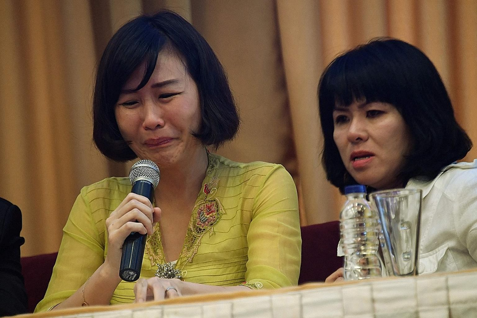 Ms Veronica Tan (left), with her sister-in-law Fifi Lety Indra, reading out an impassioned letter by her husband Basuki Tjahaja Purnama (right, speaking to his lawyers after the guilty verdict in his blasphemy trial in Jakarta on May 9) at a press co
