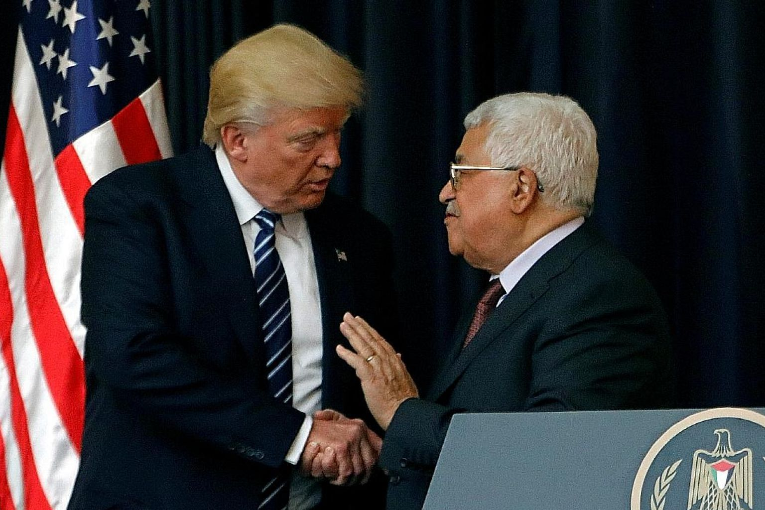 US President Donald Trump with Palestinian President Mahmoud Abbas in Bethlehem yesterday. The two men had a private meeting. Israeli Prime Minister Benjamin Netanyahu and Mr Trump chat during their meeting in Jerusalem yesterday. With them was White